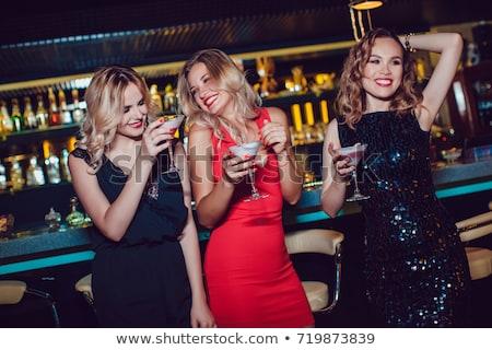 girls enjoying nightlife in a club drinking cocktails stock photo © kzenon