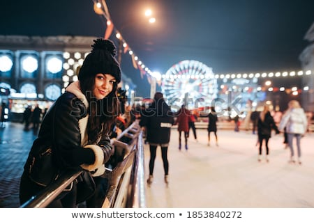 Happy beautiful young woman in New year dress with hood Stock photo © deandrobot