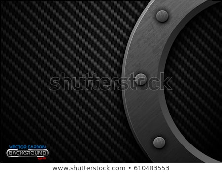 Foto d'archivio: Vector Black Carbon Fiber Background Dark Grunge Metal Ring And Rivet Scratched Riveted Surface