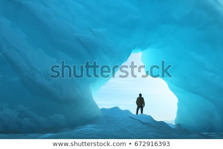 Young man under an ice arch Stock photo © orla