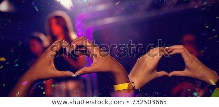Mains public forme de coeur stade montrent discothèque Photo stock © wavebreak_media