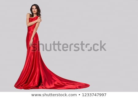 Young girl in red dress on gray background Stock photo © julenochek