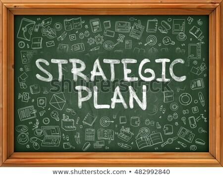 strategic plan concept green chalkboard with doodle icons stock photo © tashatuvango