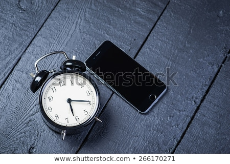 working hours vintage clock and mobile phone stock photo © stevanovicigor