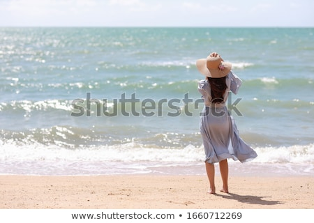 Portrait of a asian woman in dress and hat posing stock photo © deandrobot