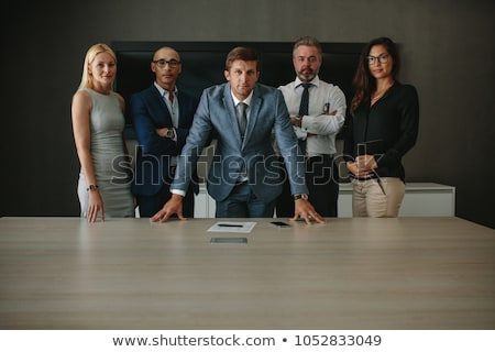 Businessman by conference table Stock photo © IS2