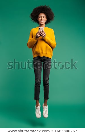 Full length portrait of a happy afro american woman Stock photo © deandrobot