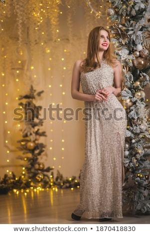 beautiful girl in evening dress surrounded by light stock photo © svetography