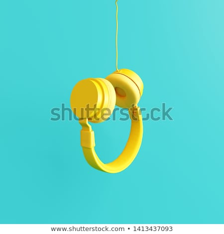 retro headphones on a yellow background stock photo © studiostoks