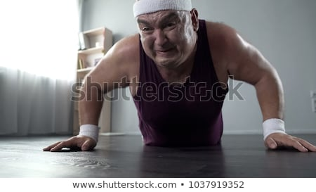 Man trying to lose weight Stock photo © ichiosea