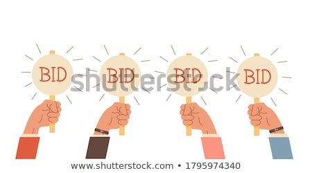 Hand holding auction paddle. Bidding concept. Auction competition. vector Stock photo © Andrei_