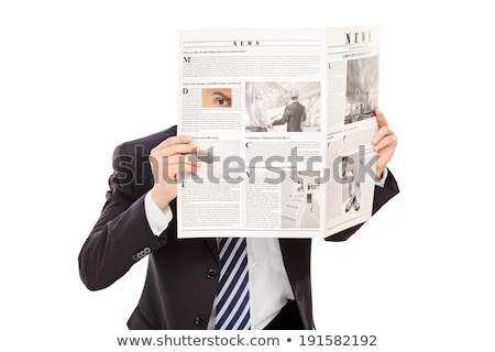 Man spying through hole in newspaper Stock photo © IS2
