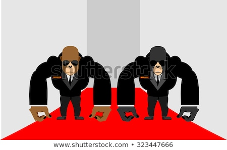 Security Guards of a gorilla. Big Bodyguards Primates in costume Stock photo © popaukropa