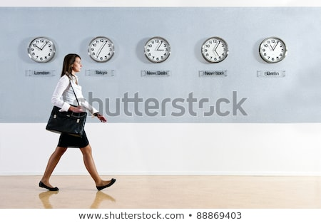 Business woman walking, with purse Stock photo © IS2