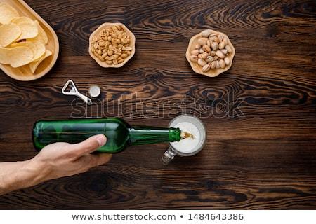 Homem cerveja vidro bar contrariar Foto stock © wavebreak_media