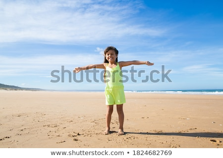 Girl smiling with arms spread Stock photo © IS2