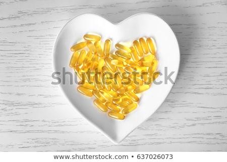 természetes · halolaj · tabletta · kiegészítő · omega · 3 · zsíros - stock fotó © dolgachov