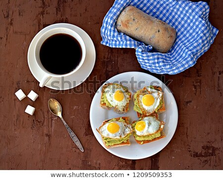 healthy sandwich with fresh avocado and fried quail eggs stock photo © melnyk