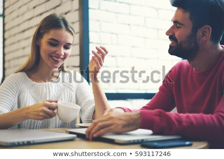Two best friends talking while drinking together a cup of coffee Stock photo © Kzenon