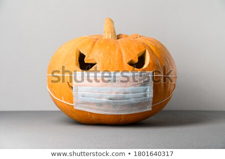 Halloween pumpkin carved portrait with spooky face Stock photo © SwillSkill