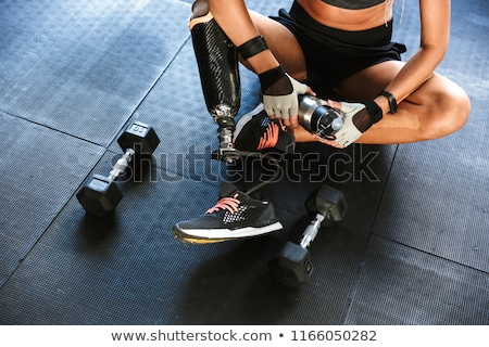Cropped photo of healthy handicapped invalid woman in tracksuit  Stock photo © deandrobot