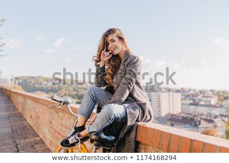 смеясь осень пальто ноутбука Сток-фото © deandrobot