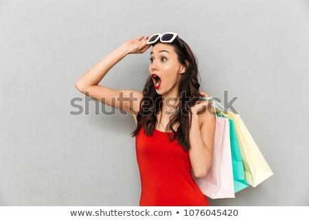 jóvenes · morena · mujer · gris · tocar - foto stock © deandrobot