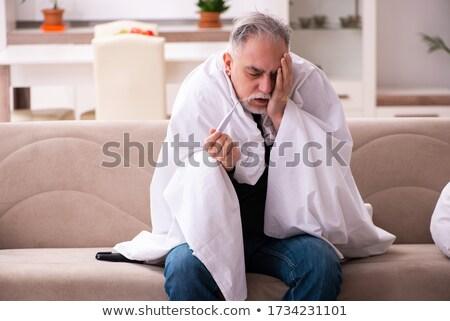 férfi · szenvedés · fejfájás · ágy · fiatalember · hálószoba - stock fotó © andreypopov