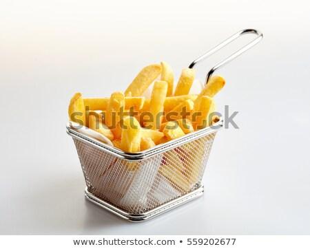 Stockfoto: Basket Of Freshly Made French Fries On White Studio Background