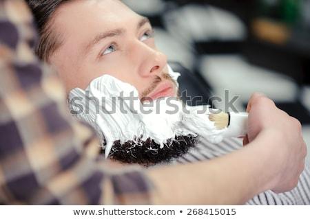 Barbier crème clientèle visage client barbe Photo stock © Kzenon