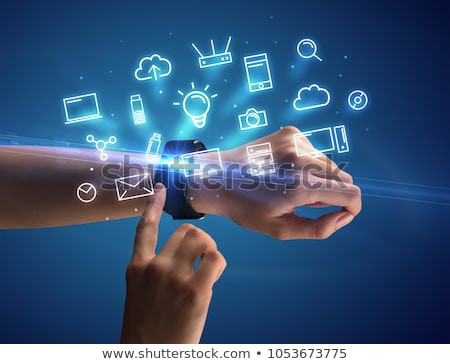 hand wearing smartwatch with multimedia symbols stock photo © ra2studio