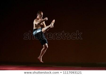 Atleet kick been springen man sport Stockfoto © Andreyfire