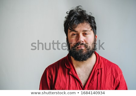 Portrait of an exhausted young bearded man Stock photo © deandrobot
