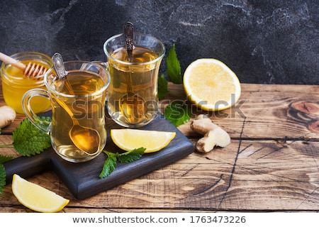 Stock photo: Healthy tea two cups with lemon, ginger, mint