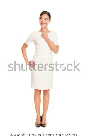 portrait of a pensive asian woman in dress standing stock photo © deandrobot