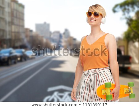 teenage girl with skateboard over san francisco Stock photo © dolgachov