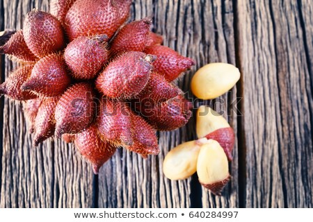 Close up Salak fruits on wood table,Thai and Indonesian local fruits Stock photo © galitskaya
