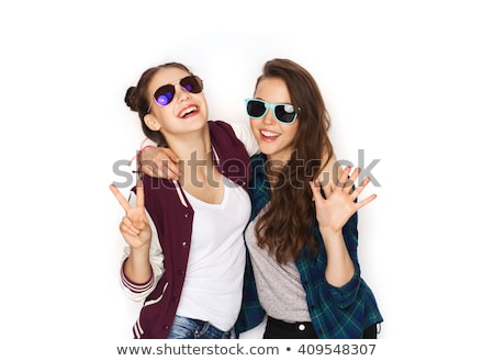 teenage girls in sunglasses showing peace sign stock photo © dolgachov