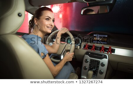 Pretty, young woman  passing through a car wash with her car Stock photo © lightpoet