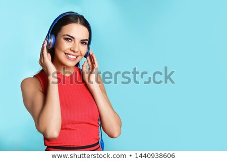 Smiling attractive young woman enjoying music Stock photo © Giulio_Fornasar