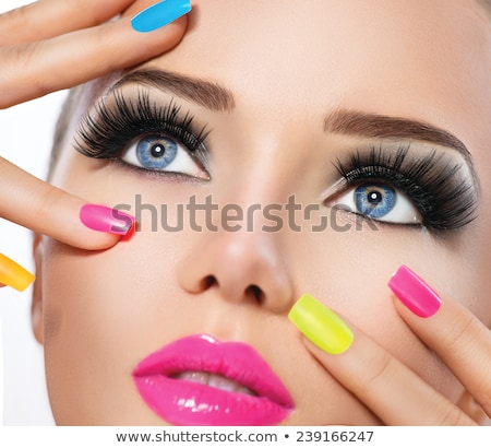 Woman's face with vivid make-up and colorful nail polish Stock photo © serdechny