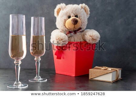 Beautiful women holding gift boxes and two glasses with champagn stock photo © Freedomz