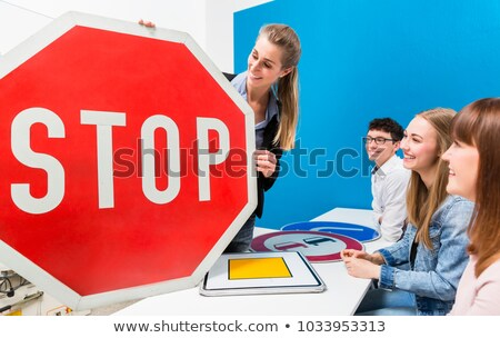 Driving instructor explaining meaning of street sign to class Stock photo © Kzenon