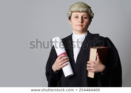 Studio Portrait Of Female Lawyer Holding Brief And Book Stock photo © HighwayStarz