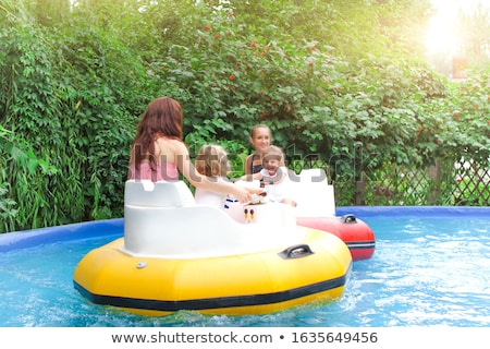 Mother with kids riding bumper boats Stock photo © dashapetrenko