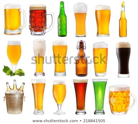 Alcoholic green beer in the glasses on a white. Stock photo © artjazz
