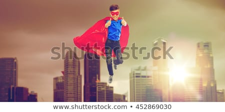 man in red superhero cape over singapore city Stock photo © dolgachov