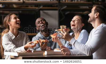 Men and women having a good time with food and drink in restaurant Stock photo © Kzenon