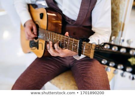 Crop man playing acoustic guitar Stock photo © dashapetrenko