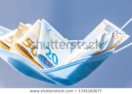 Cinque euro monete luce economia Foto d'archivio © DenisMArt